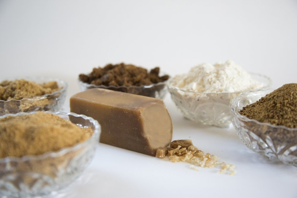 Left to right: Coconut Sugar, Light Muscovado, Dark Muscovado, Wasanbon, Piloncillo and Maple Sugar (center)