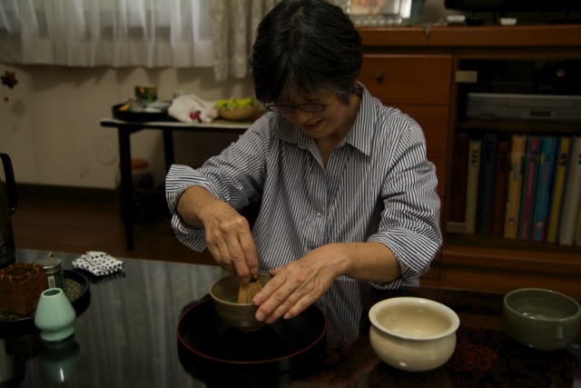 Kyoto: Our host, Keiko, showing us how to prepare matcha tea.  Photo Credit: N. J. Mangini