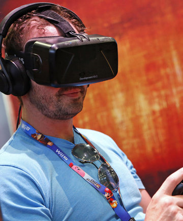 A man uses the Oculus Rift virtual reality headset at the 2014 Electronic Entertainment Expo in Los Angeles.
