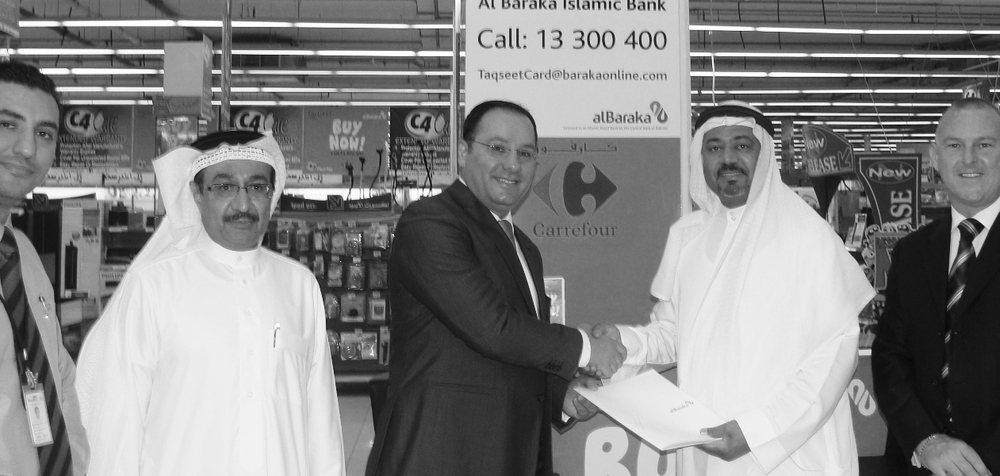 Mohamed Al Mutweh, the CEO and board member of the bank with General Manager of Carrefour Bahrain, Joe Younes and other officials
