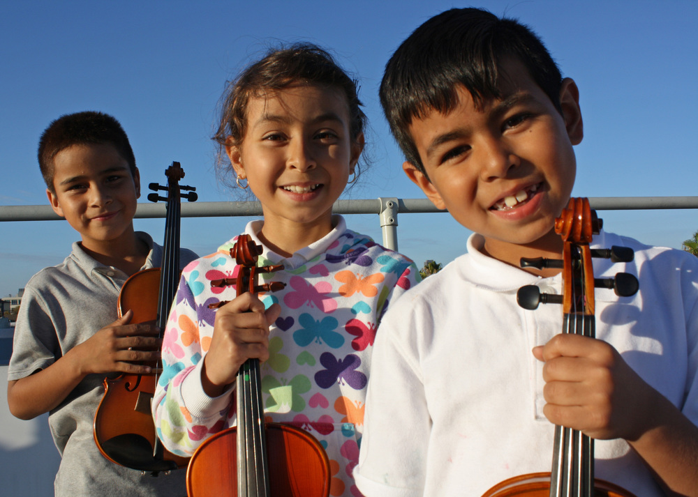 STUDENTS FROM THE MUSIC MISSION SAN FRANCISCO PROGRAM STARTED IN 2015 with 20 new instruments provided by the open string. photo BY ADRIAN ARAS/MCCLA