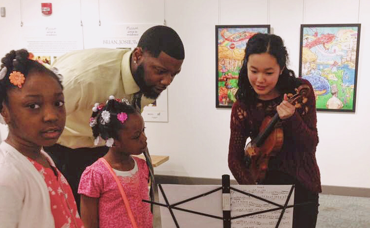 CAMMIE LEE AND ISABELLE ZHENG TEACH violin to 4Th to 6th grade students in a school with 85% disadvantaged families