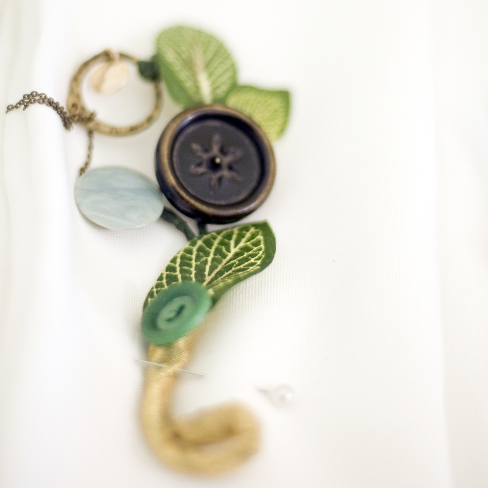 Boutonniere, antique buttons.jpg