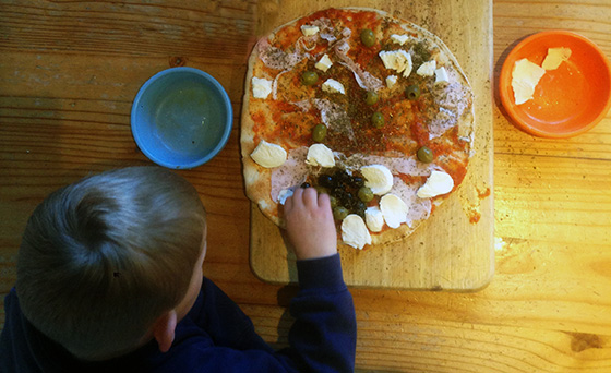 The kids love decorating their own pizzas - the only downside is they can get a bit carried away!