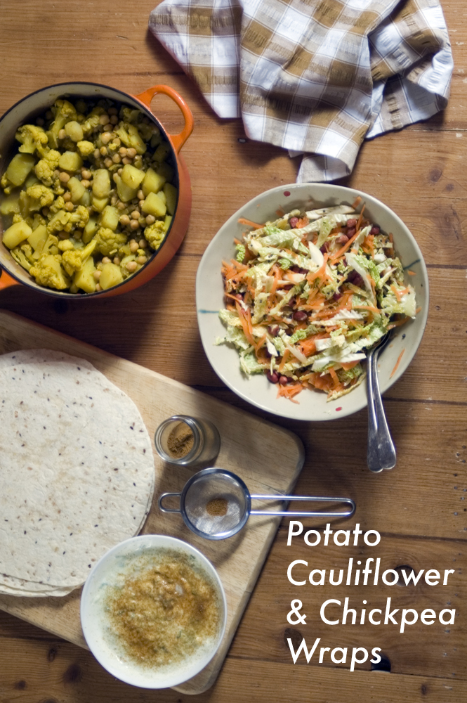 Recipe for cauliflower, potato and chickpea curry served in wraps with raita and crunchy cabbage relish. Using Mission Deli wraps. Vegetarian recipe.