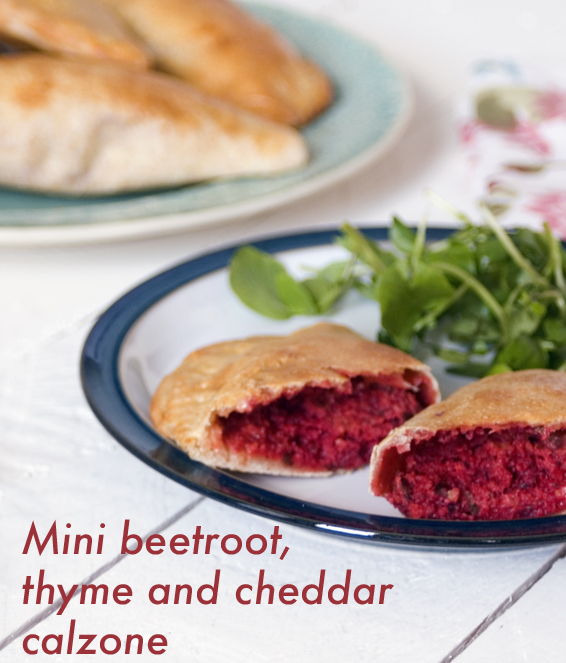 Mini calzone with beetroot, thyme and pumpkin seed pesto and cheddar cheese. Vegetarian calzone made using Haywards Pickles beetroot.