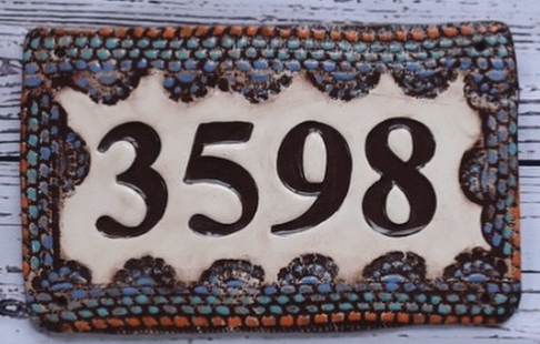 Our address plaque featured here in our popular deep brown with warm accents of blue, teal and orange.  Great for a variety of styles and color pallets.
