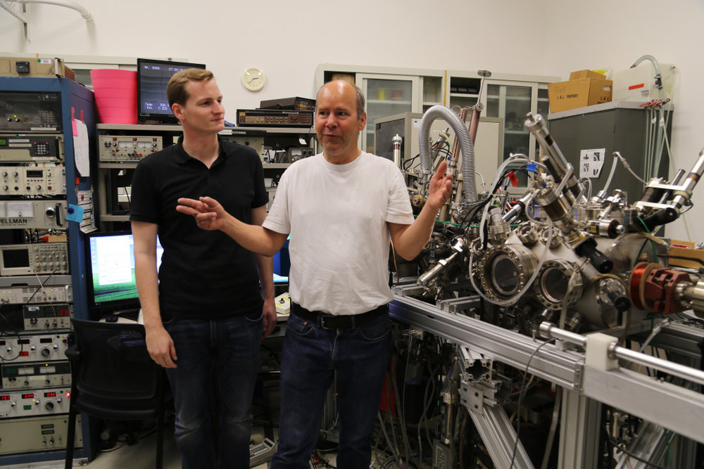 Jared Schwede (left) with Berkeley Lab scientist Andreas Shmid and his spin-polarized low energy electron microscope.