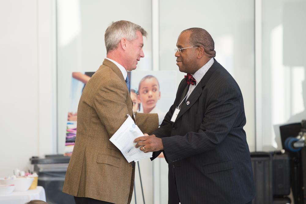 Stig Leschly greets Dr. Reverend Groover