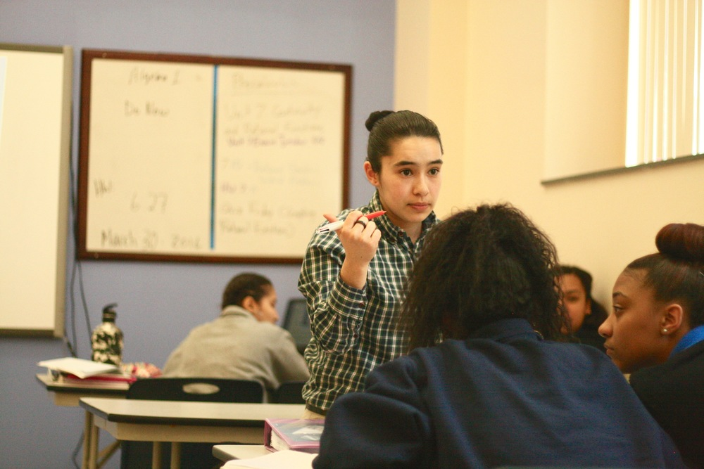Miranda-Gomez directs students in her class.