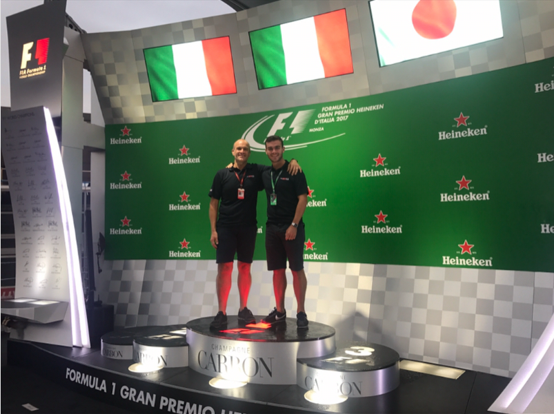 Jack (right) on the podium during his time in Italy.