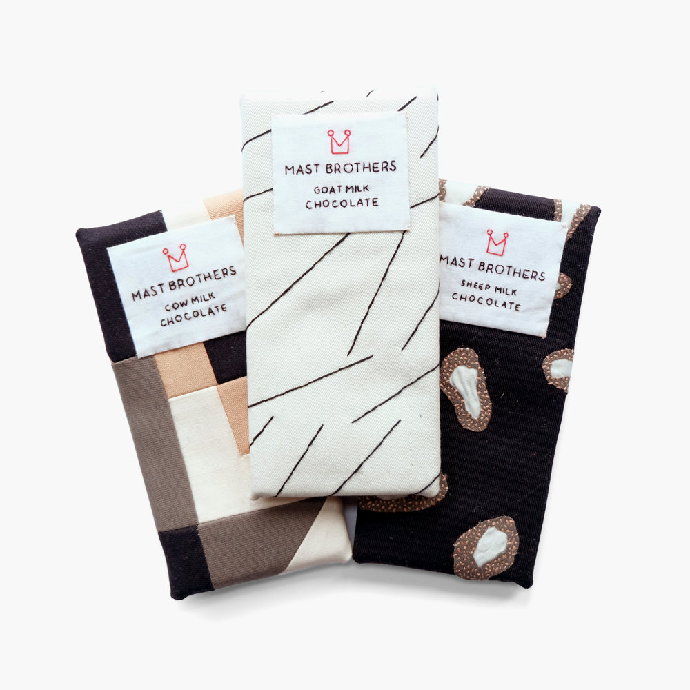 Collectible Confections    Milk Collection in Cow, Goat, and Sheep from Mast Brothers   Felt, cotton cloth, embroidery floss 6.125 x 2.875 x 0.3 in each 2015