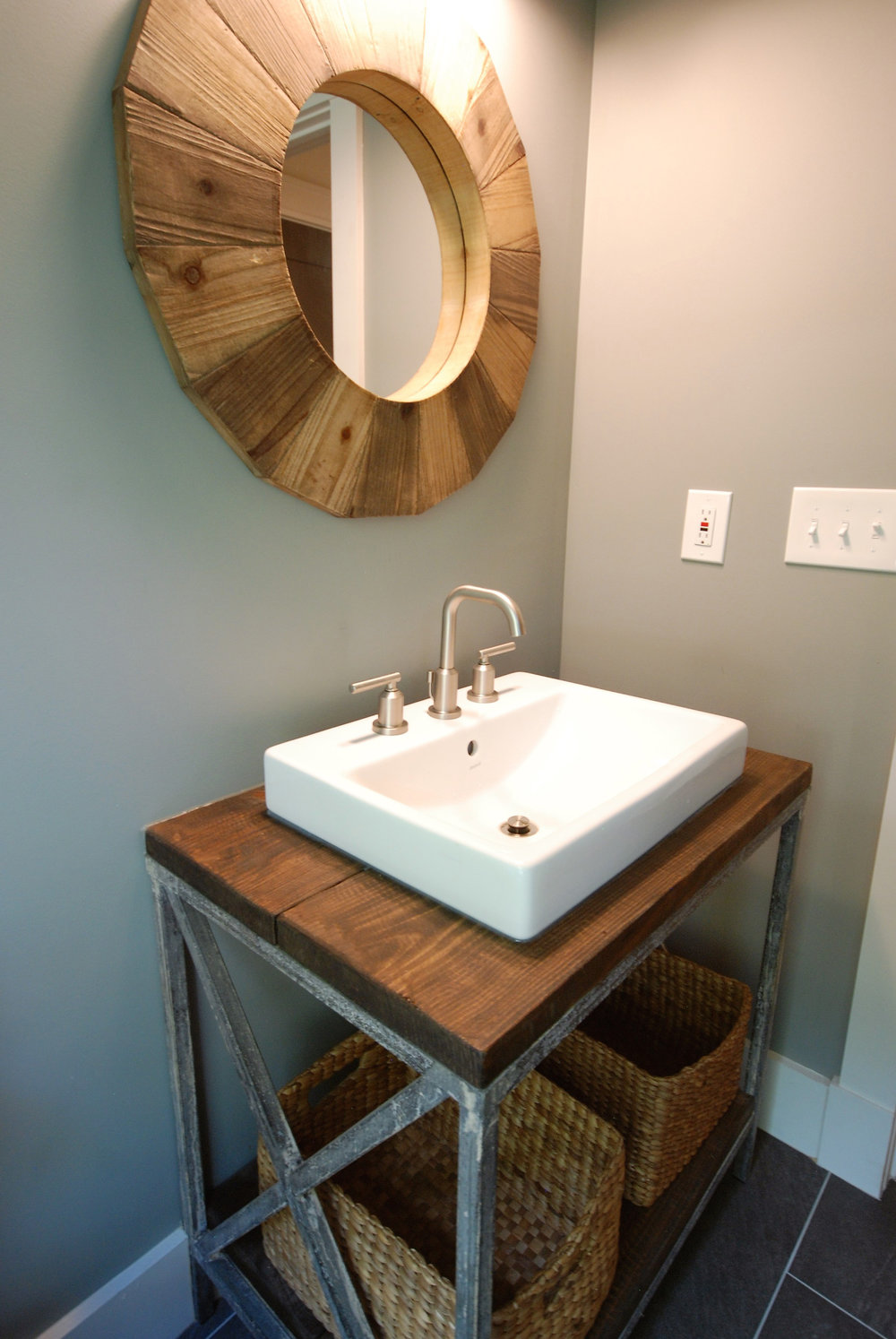 Custom iron and reclaimed wood sink