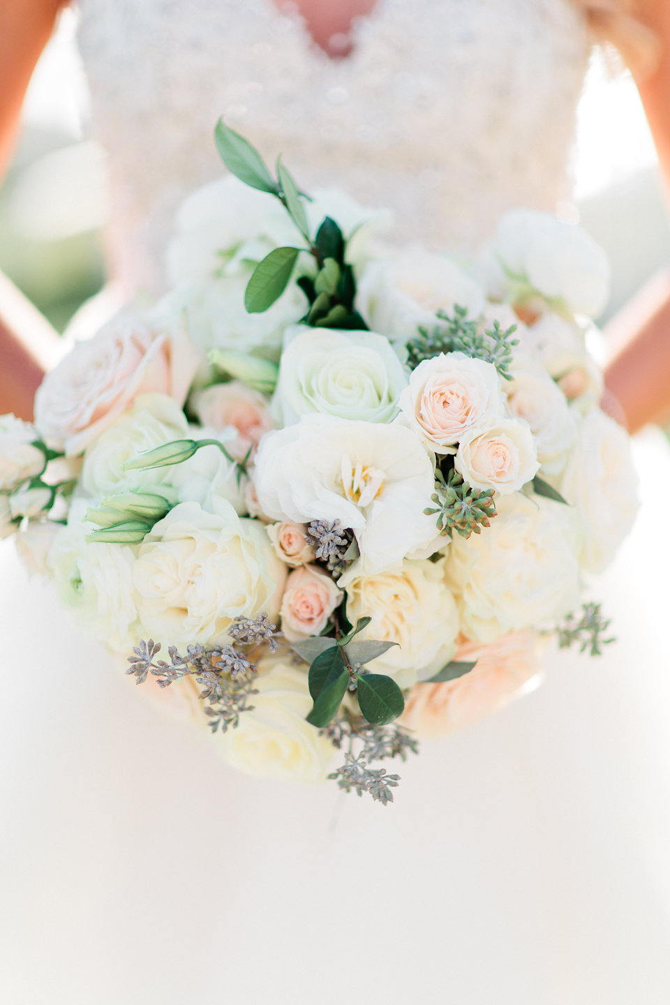 Bridal bouquet of garden roses, eucalyptus, peonies soft blush