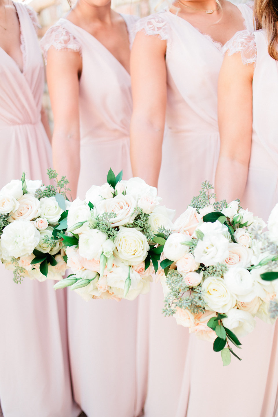 Bouquets of garden roses, eucalyptus, peonies soft blush