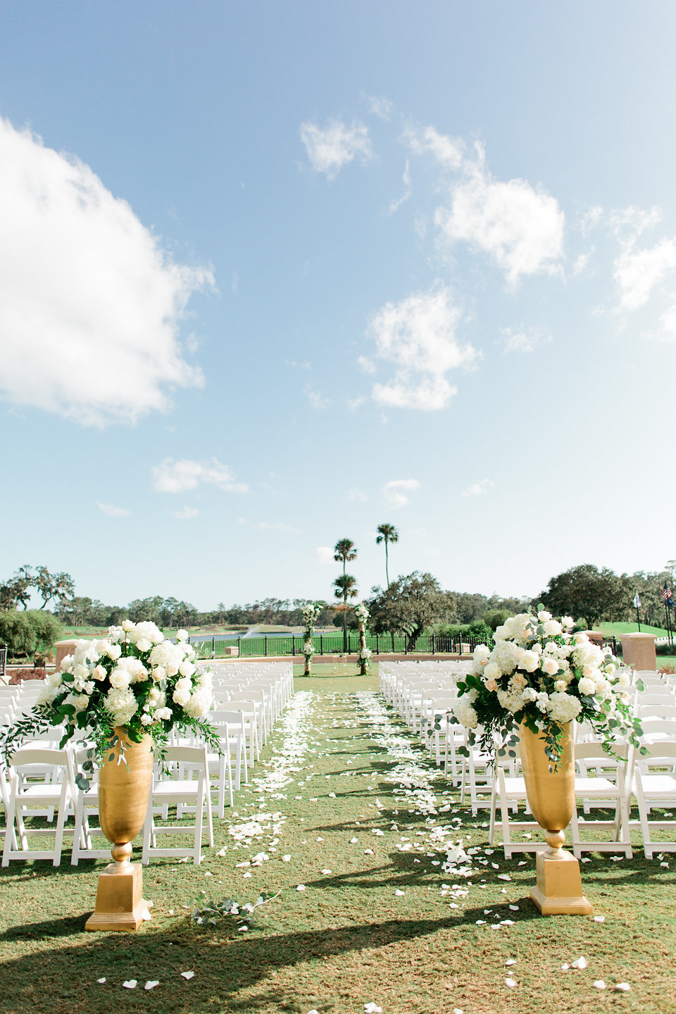 TPC Sawgrass ceremony overlooking the  golf course with blush and white floral aisle markers  Blush Wedding at TPC Sawgrass Wedding Ponte Vedra Beach  Jacksonville Wedding Planner Blue Ribbon Weddings  Jacksonville Wedding Photographer Debra Eby Photography  Wedding Ceremony & Reception at TPC Sawgrass Jacksonville