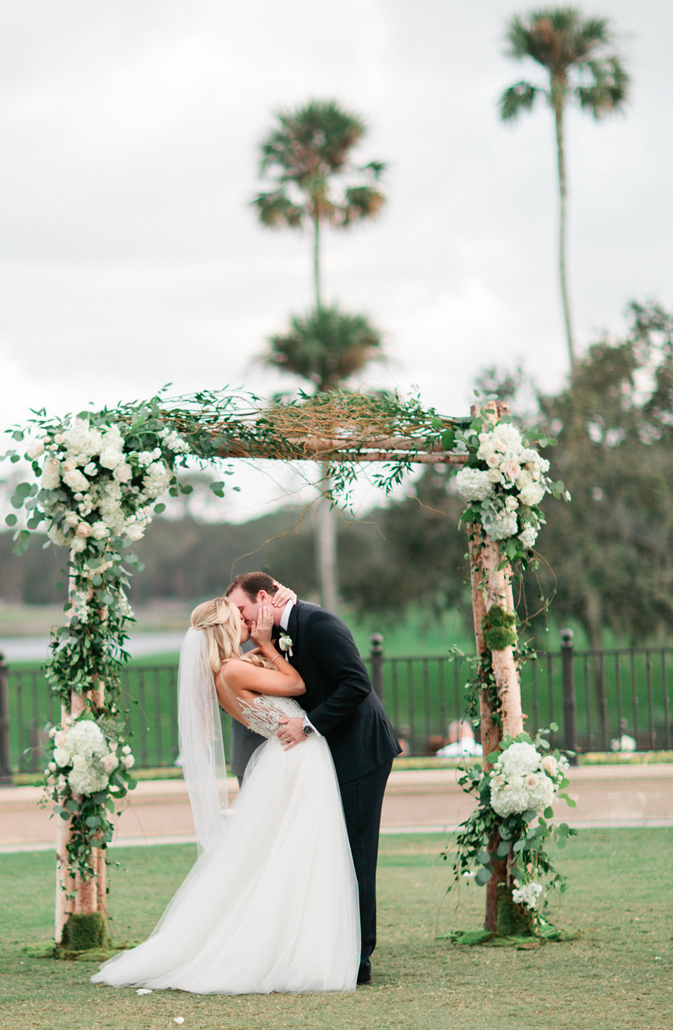 Blush and ivory blooms with greenry on wedding arch TPC Sawgrass Jacksonville  Blush Wedding at TPC Sawgrass Wedding Ponte Vedra Beach  Jacksonville Wedding Planner Blue Ribbon Weddings  Jacksonville Wedding Photographer Debra Eby Photography  Wedding Ceremony & Reception at TPC Sawgrass Jacksonville