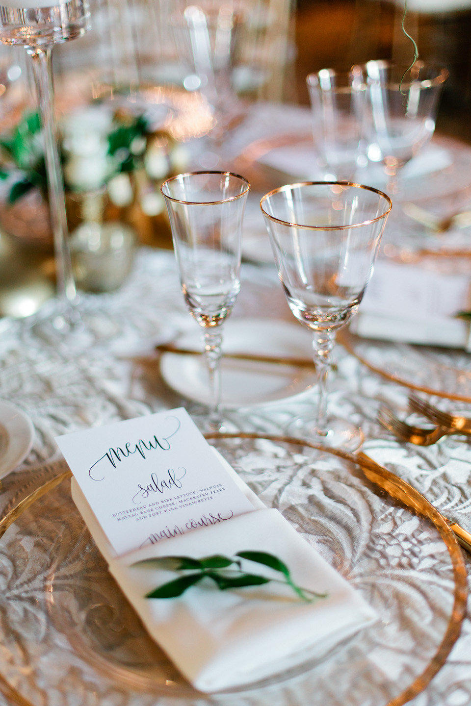 Blush and White Reception Tablescape  Gold Rimmed Glass Chargers with Menu and Greenery Sprig  Blush Wedding at TPC Sawgrass Wedding Ponte Vedra Beach  Jacksonville Wedding Planner Blue Ribbon Weddings  Jacksonville Wedding Photographer Debra Eby Photography  Wedding Ceremony & Reception at TPC Sawgrass Jacksonville