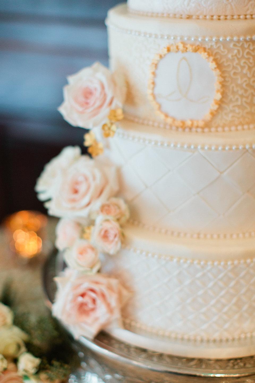 Monogrammed wedding cake with blush roses