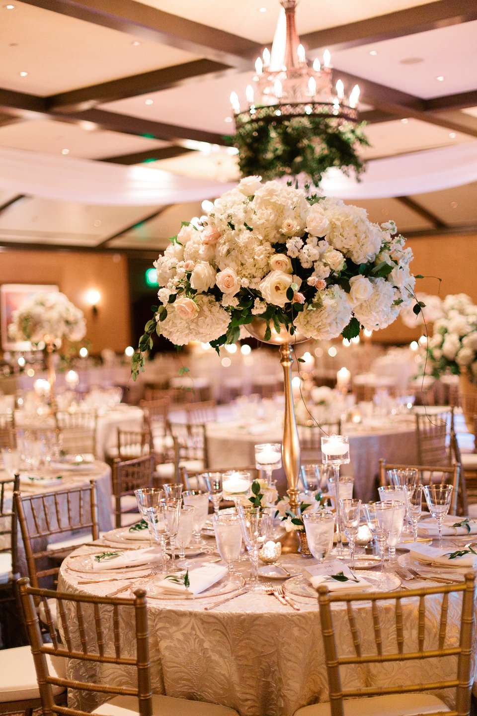 Greenery and draping with large blush and gold centerpieces at the TPC Sawgrass Clubhouse  Blush Wedding at TPC Sawgrass Wedding Ponte Vedra Beach  Jacksonville Wedding Planner Blue Ribbon Weddings  Jacksonville Wedding Photographer Debra Eby Photography  Wedding Ceremony & Reception at TPC Sawgrass Jacksonville