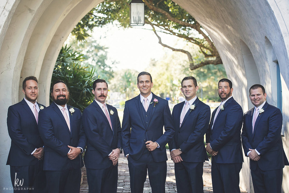 Groom and groomsmen in navy suits at Casa Feliz wedding