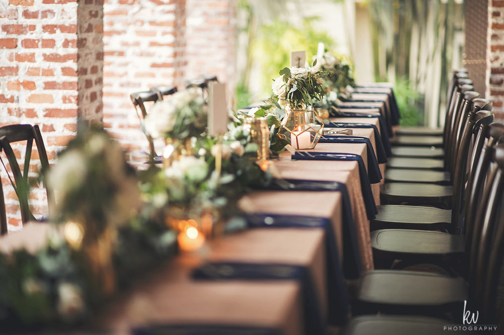 Reception banquet tables with garland centerpieces
