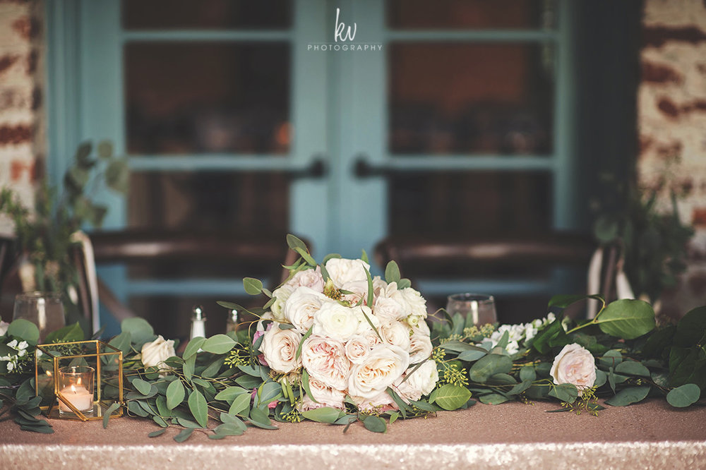 Bridal bouquet as table decor, full of ivory and blush roses