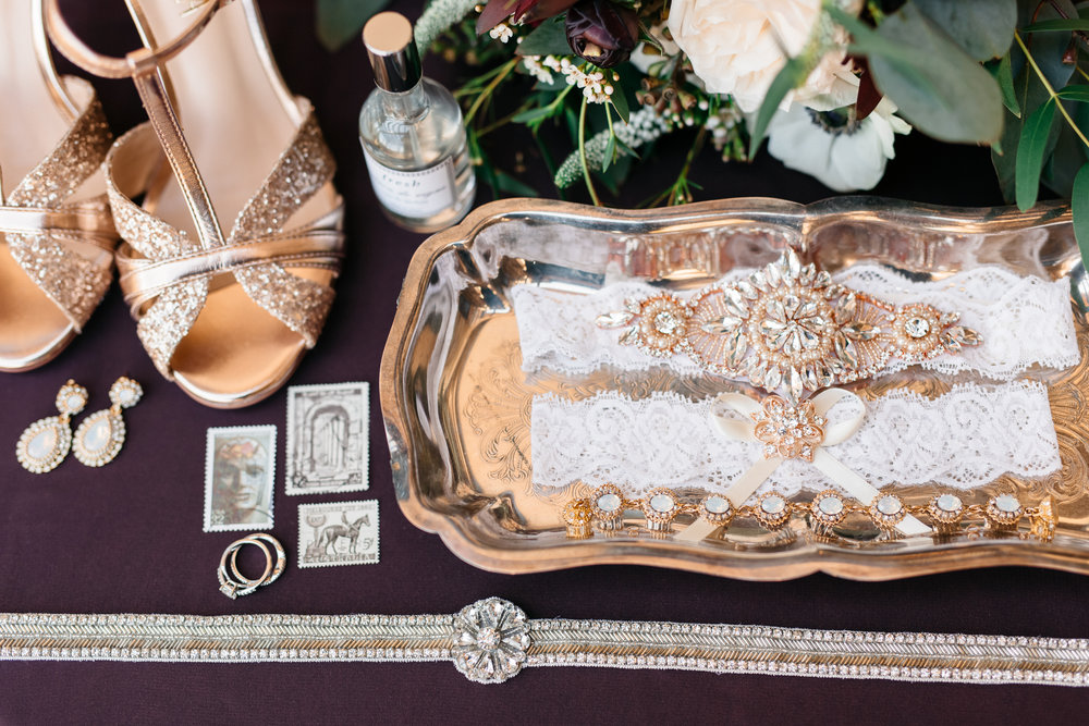 Glittery heels, wedding rings, perfume, garters - all of the Bride's wedding details