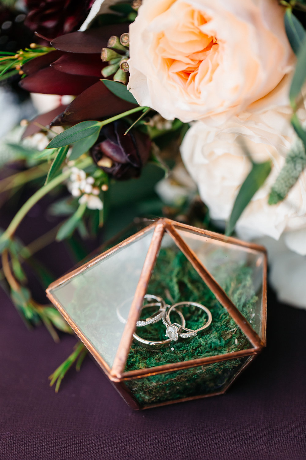 Golden terrarium encasing wedding rings, Bella Collina Wedding