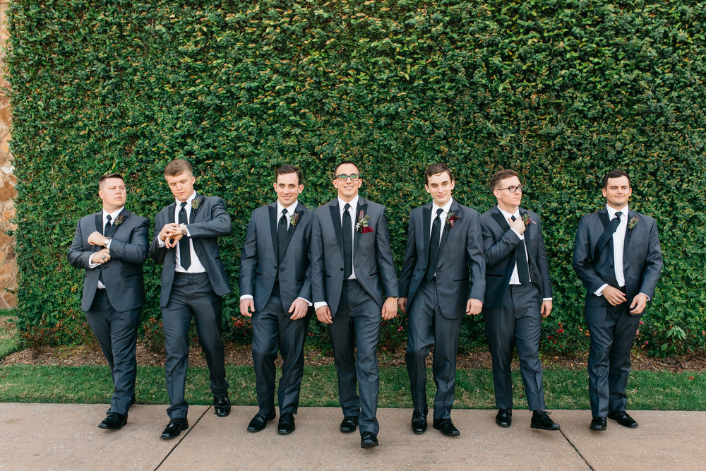 Andrew and his groomsmen in gray suits
