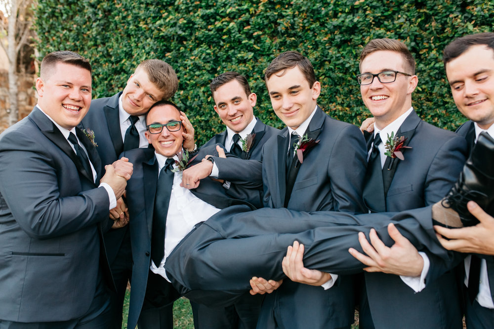 Groomsmen showing their affection toward the groom, Andrew