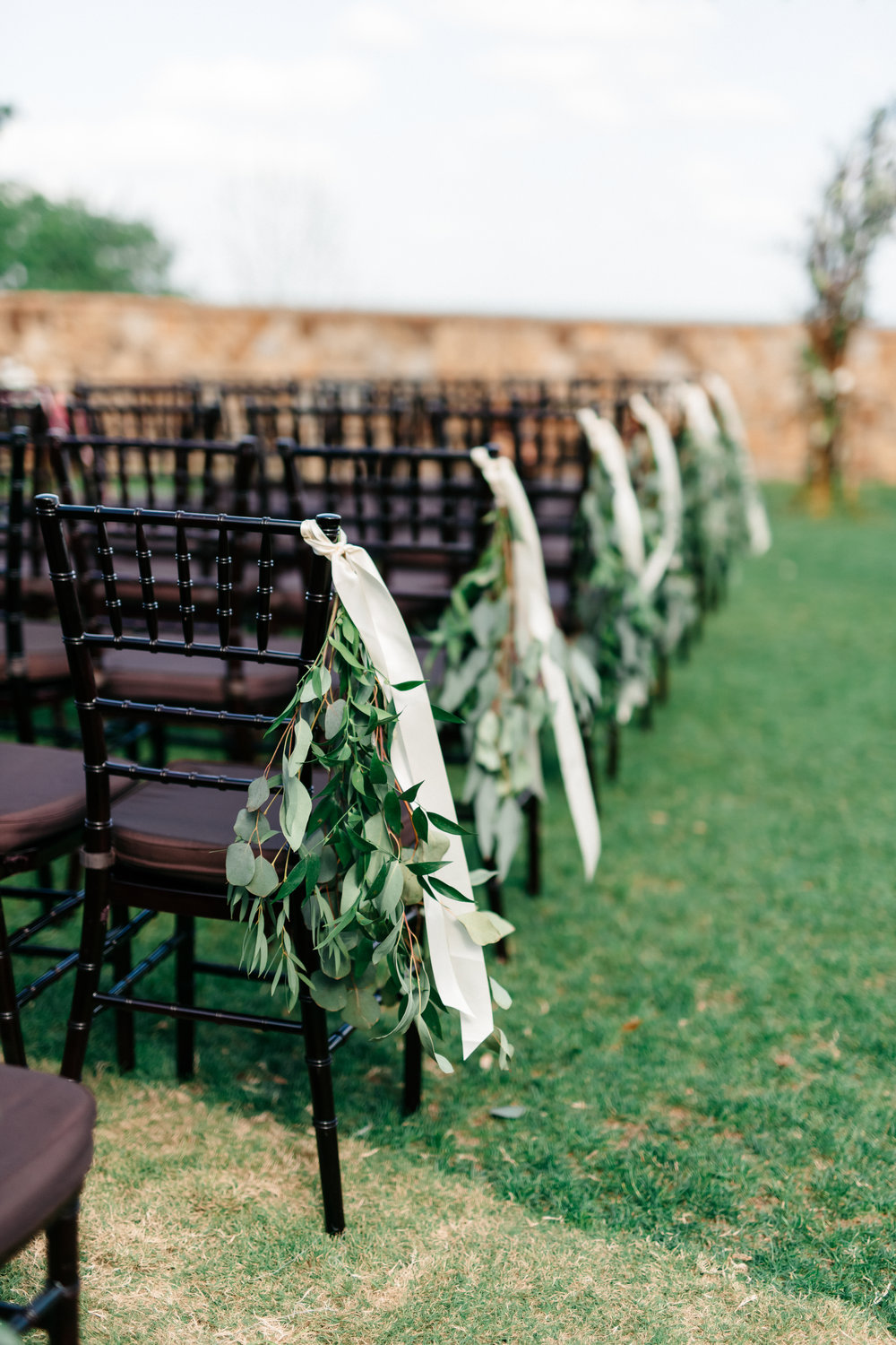 Ceremony aisle florals, lawn wedding ceremony at Bella Collina
