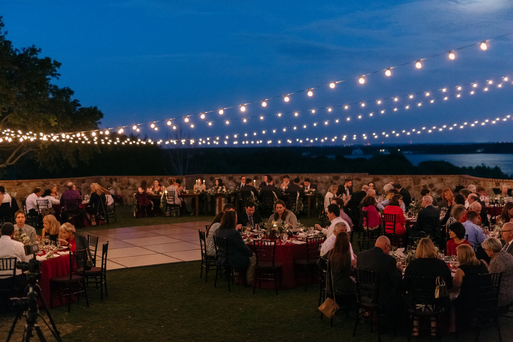 Glowing market lights complete the more romantic wedding reception