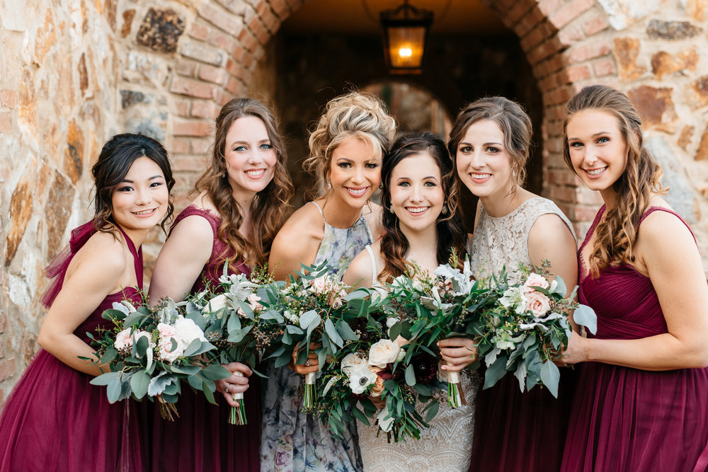 Sammy and her bridesmaids in maroon chiffon dresses