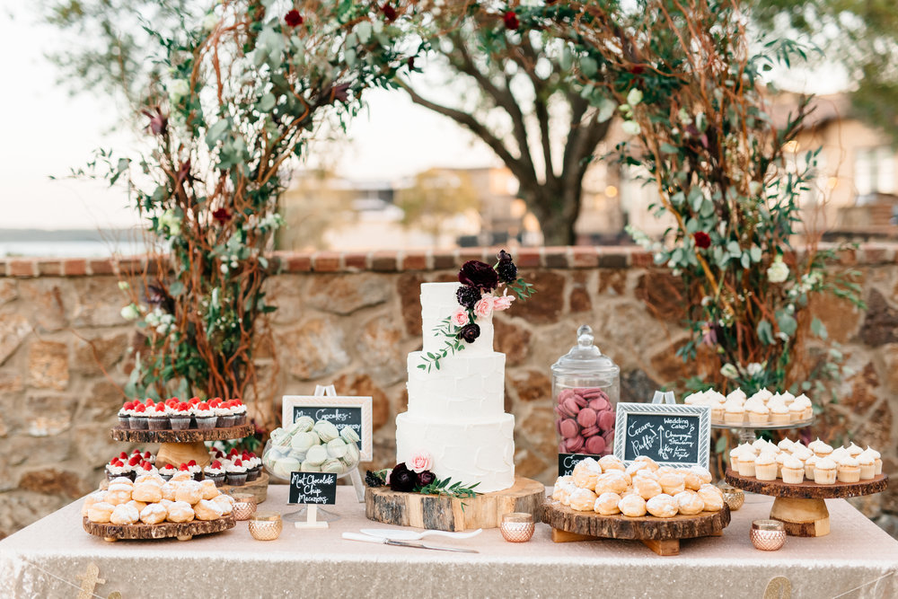 How sweet is this dessert table, macarons, mini cupcakes and three tier wedding cake