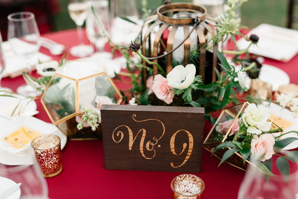 Gold lanterns, gold terrariums, mercury gold votives filled with florals