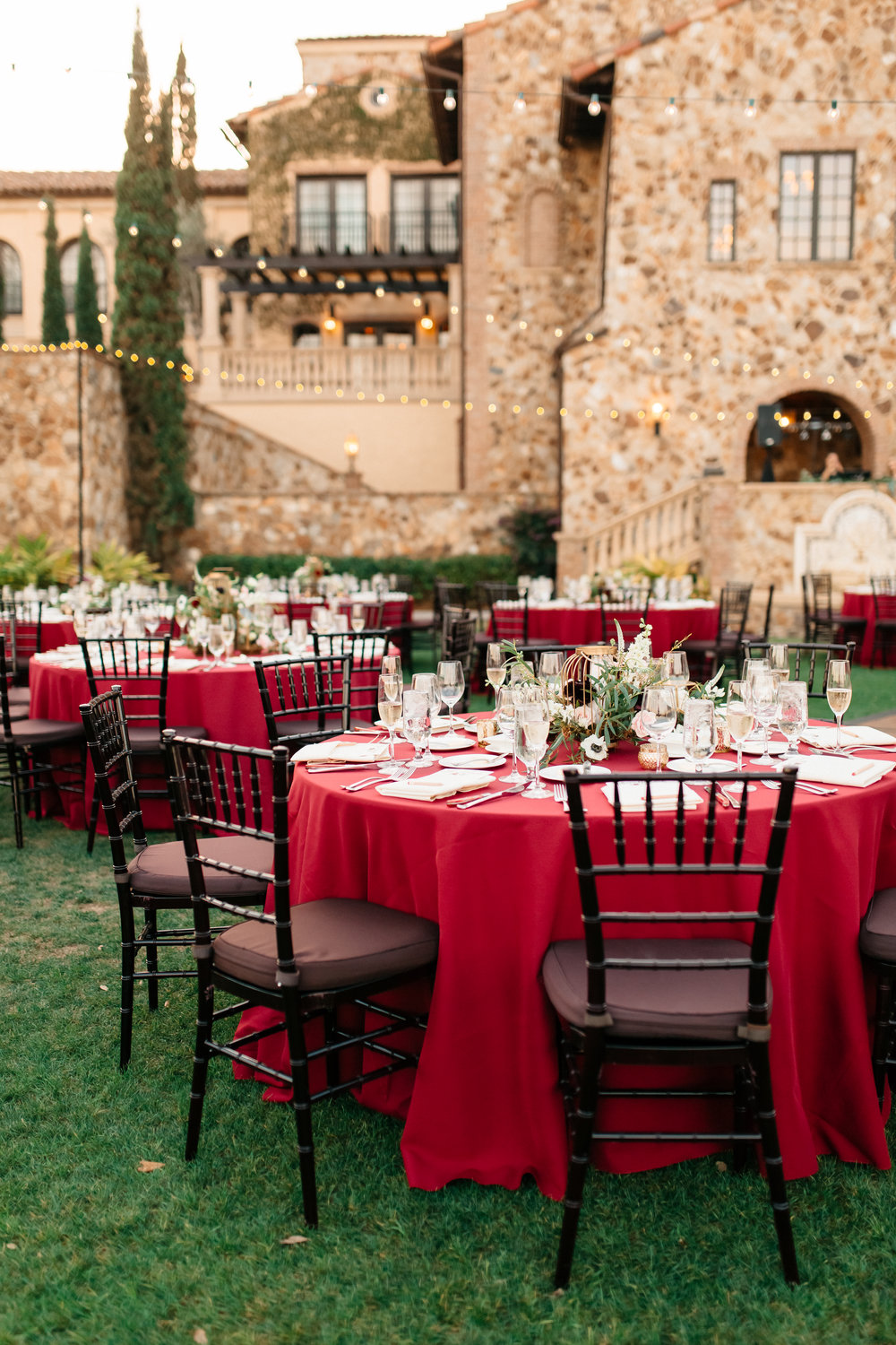 Red linens on guest tables, Bella Collina Lawn Reception
