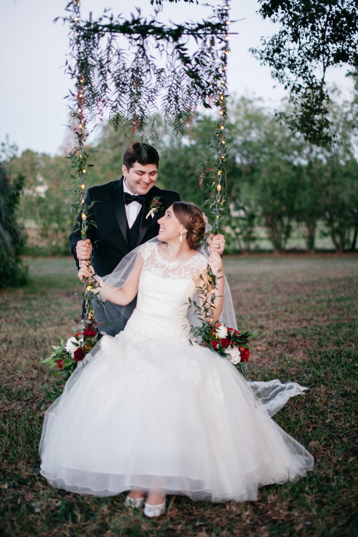 Newly weds on the backyard swing, Windermere Weddings