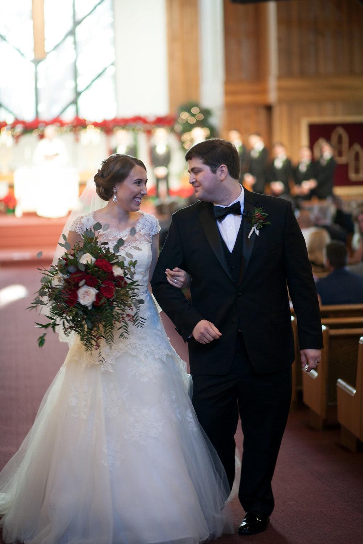 Walking down the aisle as husband and wife, St. Luke's United Methodist