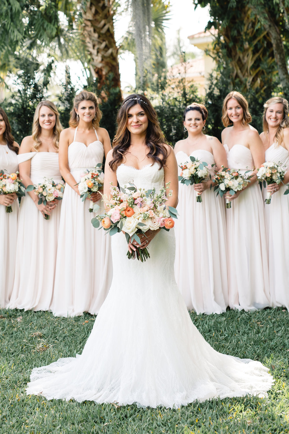 The bride + her bridesmaids