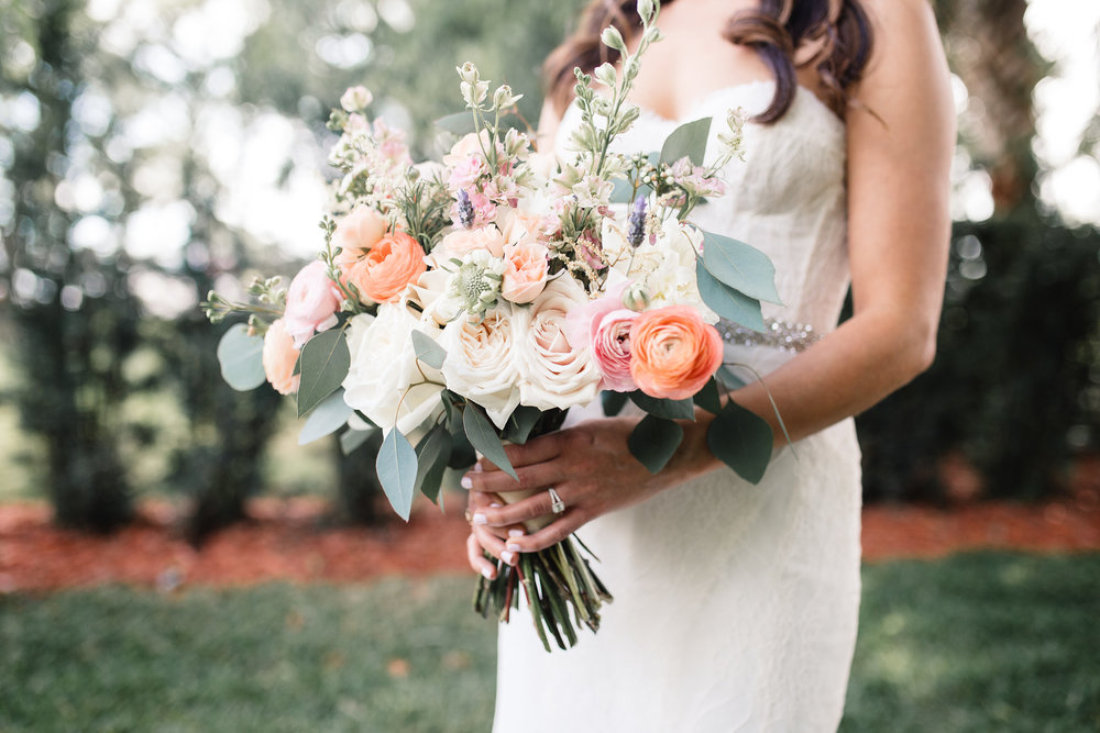 Blush and peach organic bridal bouquet with ranunculus, garden roses, astilbe, stock, wax and eucalyptus  Blush & White Garden wedding at Luxmore Grande Estate in Orlando, Florida  Orlando Wedding Planner Blue Ribbon Weddings  Orlando Wedding Photographer JP Pratt Photography  Wedding Ceremony & Reception at Luxmore Grande Estate