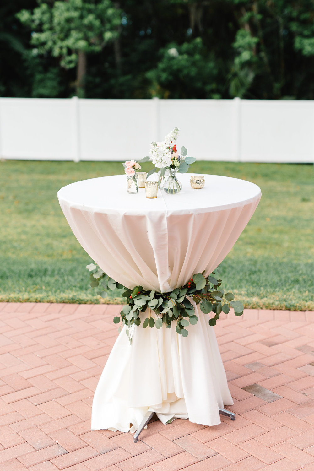 Cocktail hi top table with garland sash