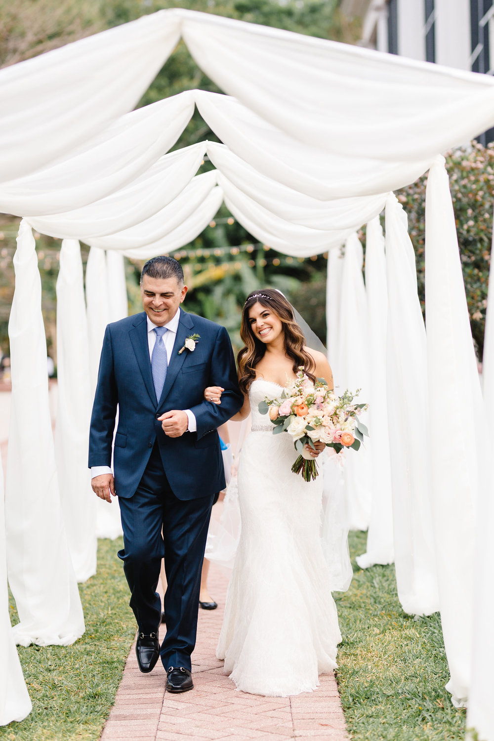 Blushing bride escorted by father, Orlando wedding ceremony