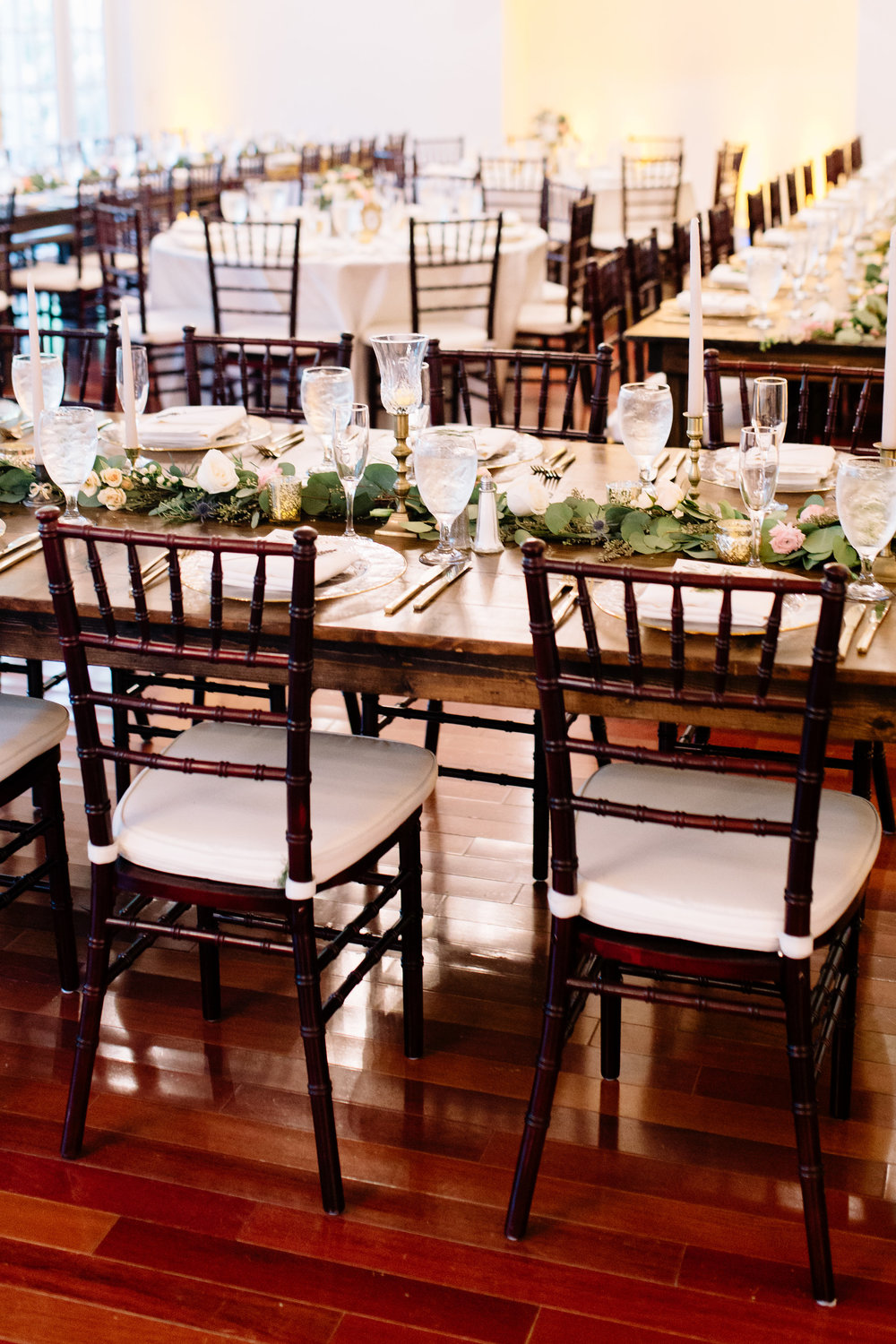 Wedding reception with wooden farm tables