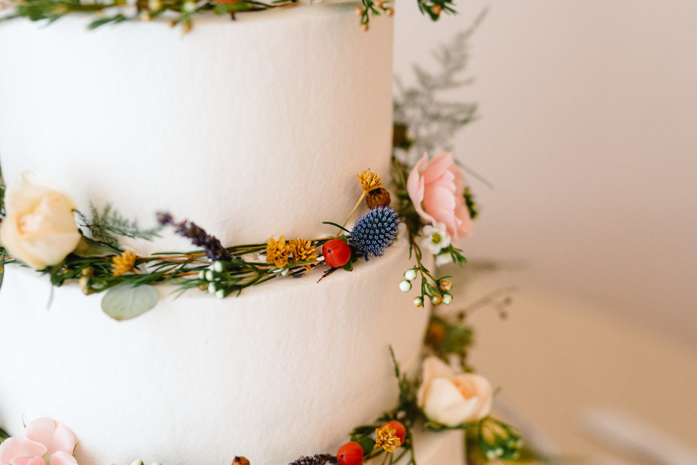 Three tier white wedding cake with floral