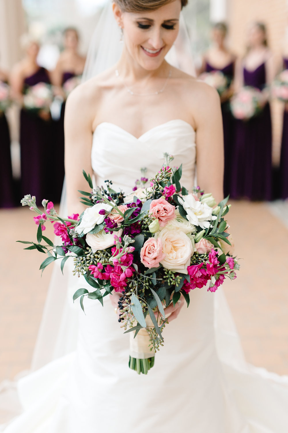 Bridal bouquet with blush peonies, bright pink larkspur, and greenery