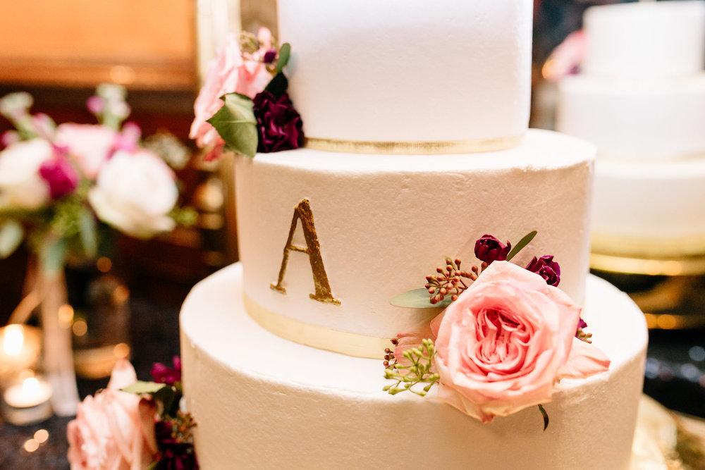 Monogrammed classic white wedding cake