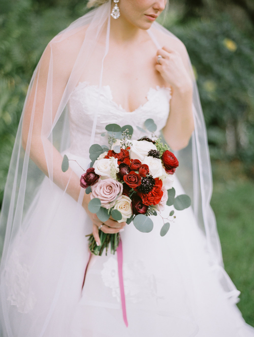 Bridal bouquet comprised of blush, red and ivory garden roses