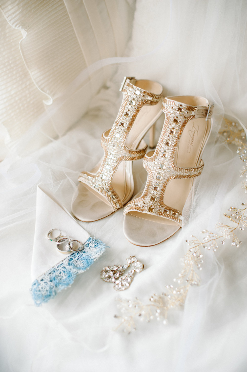 Cassie's wedding details, diamond earrings, gold heels & wedding rings