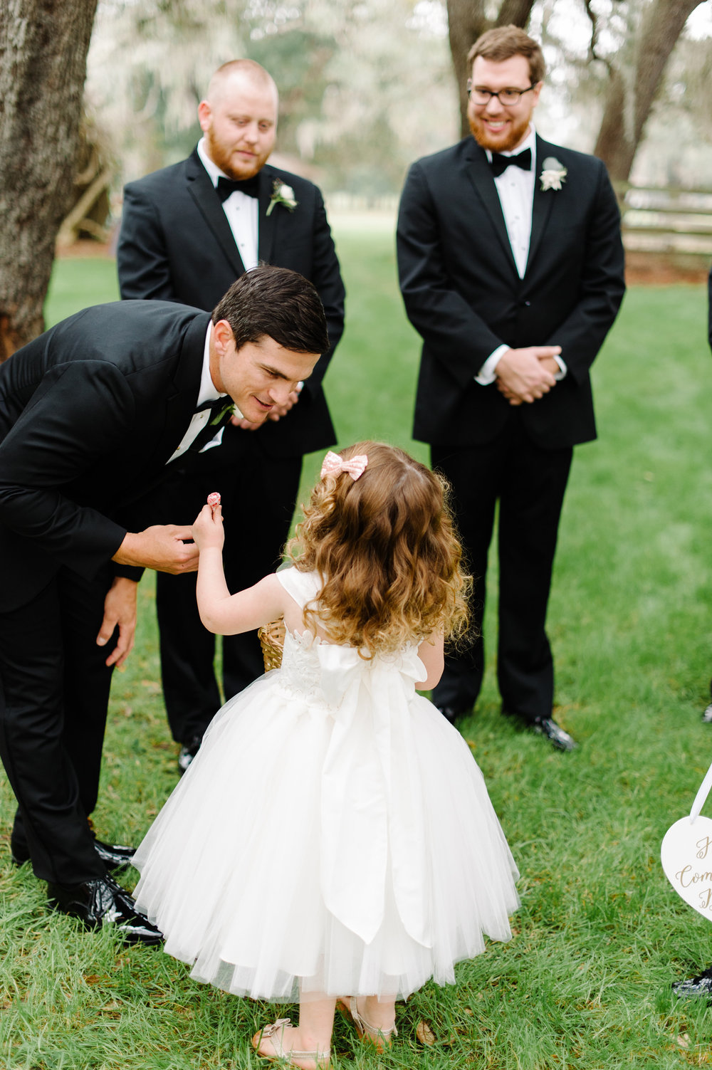 Last minute advice from the Flower Girl to the Groom